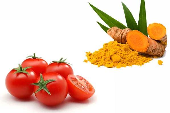 Cách trị mụn cám với cà chua kết hợp tinh bột nghệ